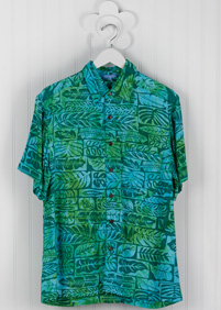 GTG Patch Fern Mens Aloha Shirt: Light blue and green Blue Ginger Hawaiian shirt with a pattern depicting different tropical leaves on a hanger in Waikiki