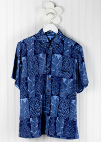 BN Pineapple Mens Aloha Shirt: Blue Ginger Hawaiian shirt with a checkered pineapple and tropical leaf pattern in different shades of blue on a hanger