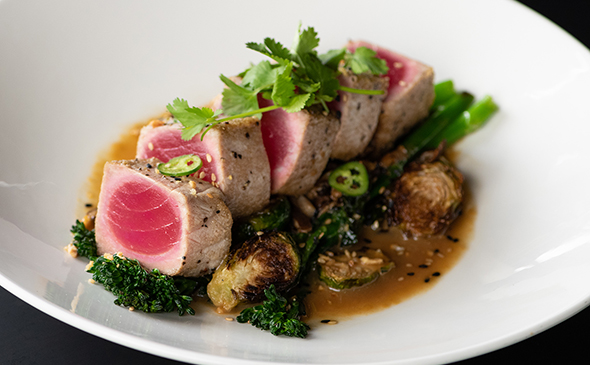 Pan seared ahi with vegetables available at Yard House Waikiki