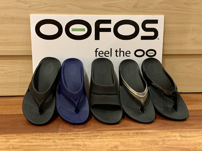 A variety of OOFOS slippers.