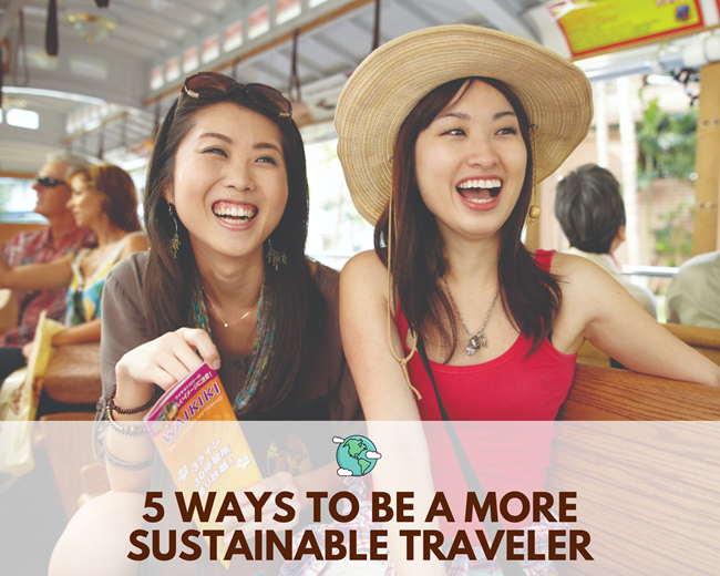2 Asian female travelers smiling on a trolley in Waikiki