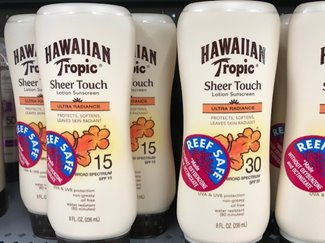 Bottles of Hawaiian Tropic sunscreen marked with Reef Safe stickers