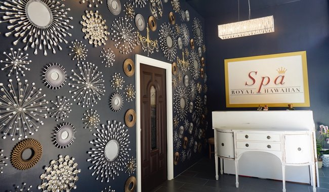 Interior shot of navy blue walls covered in decorations at Spa Royal Hawaiian in Waikiki Beach Walk