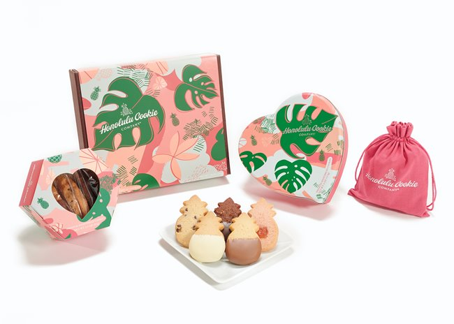 Various Valentines Collection packages next to a plate of pineapple-shaped shortbread cookies from Honolulu Cookie Company