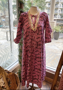 Brown & pink Ginger dress with tapa pattern on mannequin