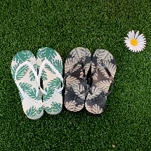 2 pairs of Vionic beach sandals in white & blue as well as black & grey with a tropical leaf pattern