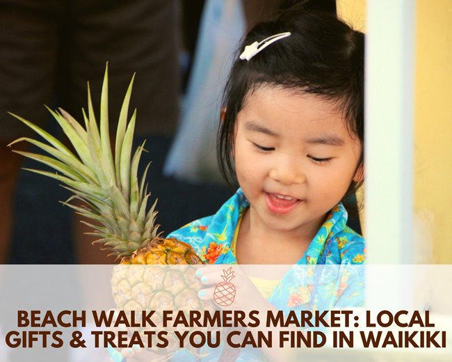 "Young girl holding a pineapple at the farmers market with the words ""Beach Walk Farmers Market: Local Gifts & Treats You Can Find in Waikiki"" underneath."