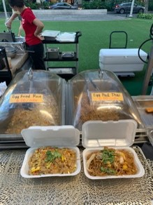 Open takeout container of pad thai and fried rice by Oh's Kitchen in Waikiki
