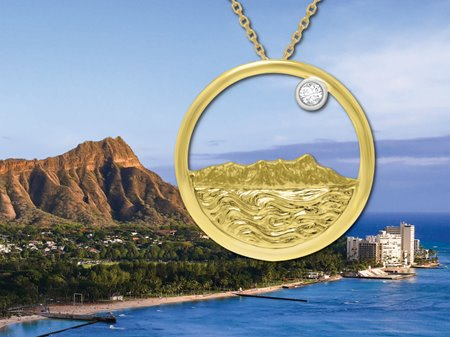 All-gold pendent cast in the shape of Diamond Head with a single round diamond in front of the real Diamond Head for comparison.